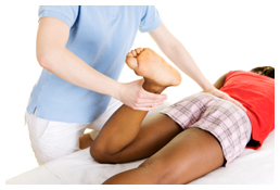 Client receiving knee treatment