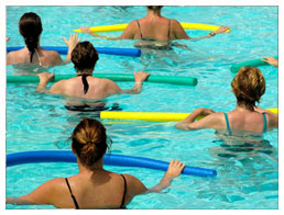 Women taking part in a water aerobics class